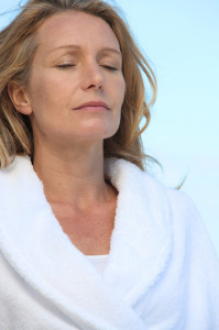 Mature woman relaxing with eyes closed